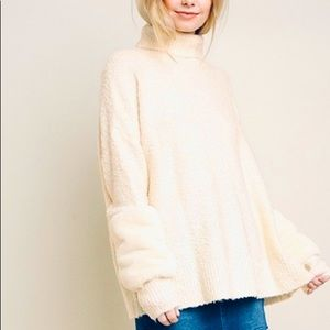 Turtleneck knit pullover sweater with fur